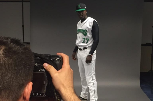 Reds prospect Aristides Aquino poses on player photo day Tuesday. (Photo tweeted by the Dayton Dragons)