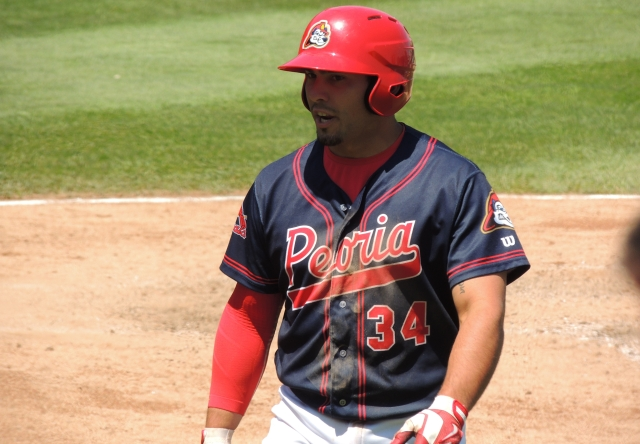 Peoria Chiefs 1B Alex DeLeon walks back to the dugout after hitting a two-run homer in the bottom of the 8th inning.