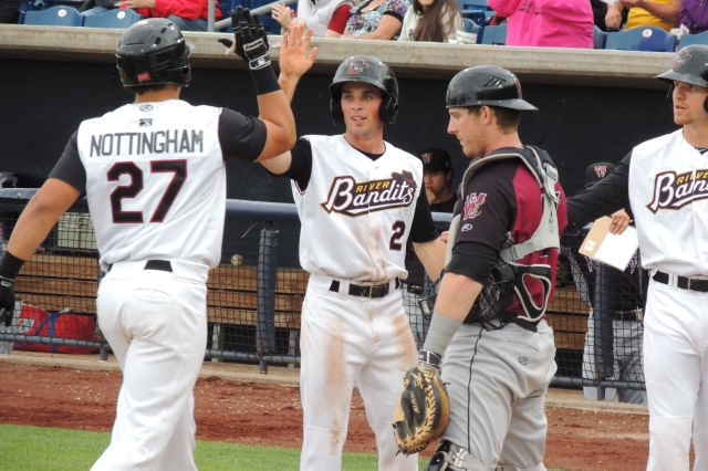 Jacob Nottingham gets a high-five from Bobby Boyd after hitting a 3-run homer in the 3rd inning of Saturday's game.