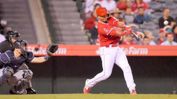 Angels catcher Carlos Perez connects for a walk-off home run in his MLB debut Tuesday. (AP photo by Mark J. Terrill)