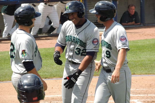 Jorge Fernandez (center) is congratulated by teammates Brett Doe (left) and Pat Kelly (right) after hitting a 3-run homer in the 2nd inning of Monday's game. (Photo by Craig Wieczorkiewicz/The Midwest League Traveler)