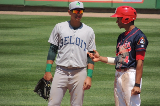 Beloit Snappers SS Edwin Diaz and Peoria Chiefs baserunner Oscar Mercado talk during a break in the action Wednesday.
