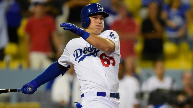 Dodgers OF Joc Pederson swings at a pitch during his MLB debut last September.  (AP photo by Gus Ruelas)