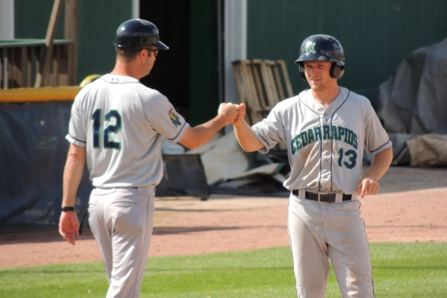 Max Murphy (right) gets a fist bump from manager Jake Mauer during Monday's game.