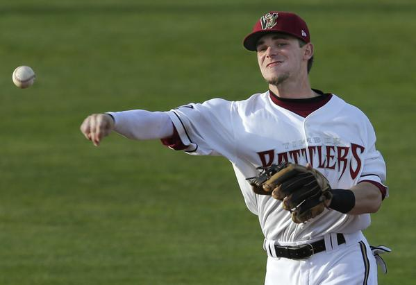 Scooter Gennett fields a ball during Friday's Timber Rattlers game. (Photo by Dan Powers/Post-Crescent Media)