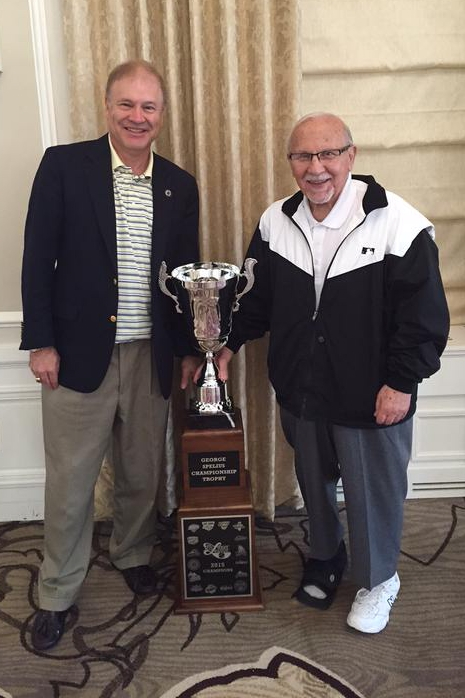 Former Midwest League president George Spelius (right) and current MWL president Dick Nussbaum pose for a photo with the George Spelius Championship Trophy last year.