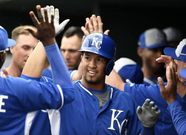 Cheslor Cuthbert high-fives a Royals teammate after hitting a home run in spring training this year. (Photo by Shane Keyser/The Kansas City Star)