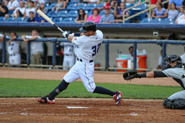 Nick Swisher connects for a single in his second at-bat for the Captains on Monday. (Photo by Tim Phillis/TCP Photography)