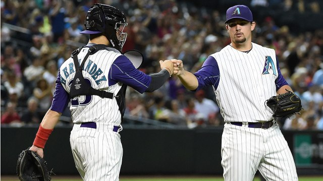 Zack Godley (right) and Oscar Hernandez celebrate a double play during the 3rd inning of Godley's MLB debut Thursday. (Photo by Norm Hall/Getty Images)