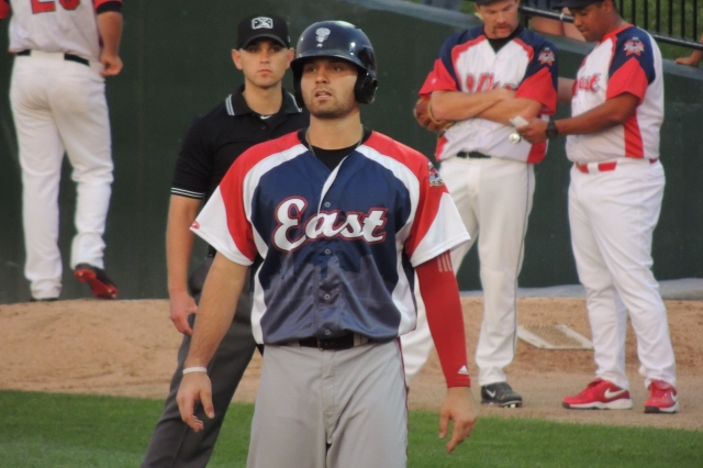 Ryan McBroom (foreground) stands at first base during the 2015 Midwest League All-Star Game. (Photo by Craig Wieczorkiewicz/The Midwest League Traveler)