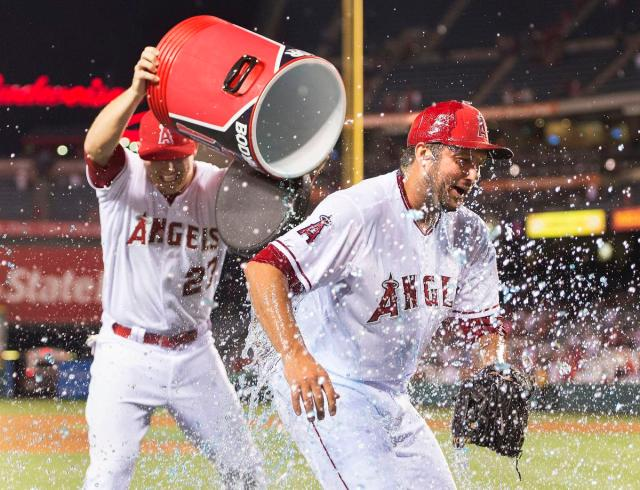Angels closer Huston Street is doused by teammate Mike Trout after Street recorded his 300th career save Wednesday. (Photo by Kevin Sullivan/Orange County Register)
