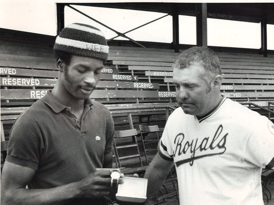 In this Des Moines Register photo, Waterloo Royals OF Willie Wilson (left) and manager John Sullivan look at a watch Wilson won for being named Kansas City's top farmhand for May 1975.