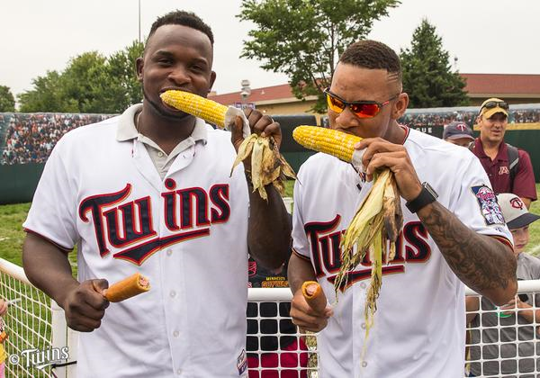 Twins rookies Miguel Sano (left) and Byron Buxton eat corn at the Minnesota State Fair on Saturday. (Photo by Brace Hemmelgarn)