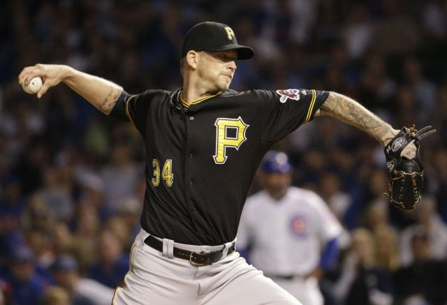 Pirates starter A.J. Burnett throws against the Cubs during the 1st inning of Sunday's game at Wrigley Field. (AP photo by Nam Y. Huh)
