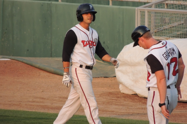Lansing Lugnuts LF Chris Carlson heads back to the dugout after grounding out in the bottom of the 1st inning.