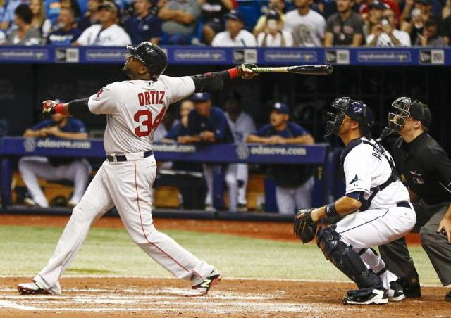 David Ortiz watches the flight of his 500th MLB homer Saturday at Tropicana Field. (Photo by Reinhold Matay/USA Today Sports)