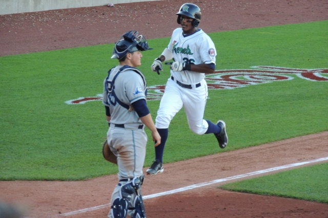 Edgar Corcino scores the tying run in the bottom of the 9th inning.