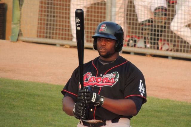 Loons 1B Justin Chigbogu looks at the bat that will later help him become the hero of the game for Great Lakes.