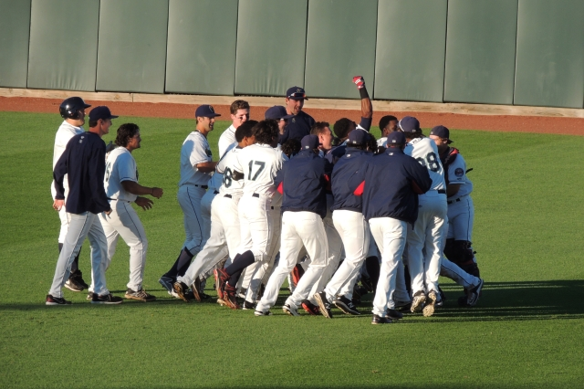 The Cedar Rapids Kernels celebrate their walk-off win in the outfield.