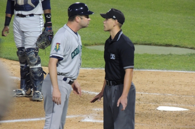 Kernels manager Jake Mauer argues with umpire Brock Ballou in the bottom of the 7th inning.
