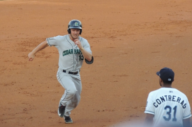 Kernels DH Max Murphy hustles to third base on his RBI triple in the top of the 2nd inning.