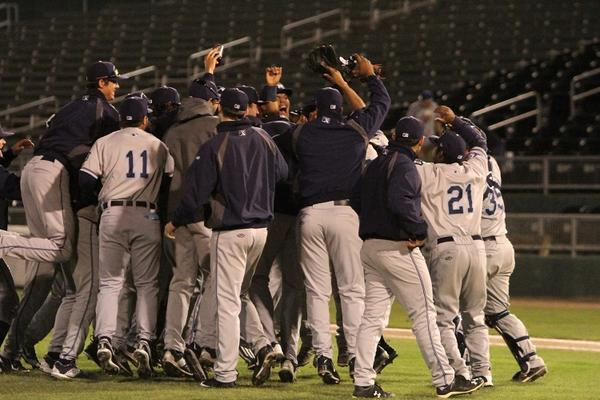 The West Michigan Whitecaps celebrate on the field after winning the Eastern Division finals Monday. (Photo tweeted by the Whitecaps)