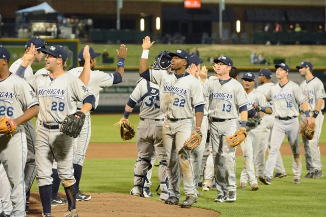 The West Michigan Whitecaps celebrate on the field after eliminating the Fort Wayne TinCaps from the playoffs with a 2-1 win Thursday at Parkview Field. (Photo by Chad Ryan/The Journal Gazette)