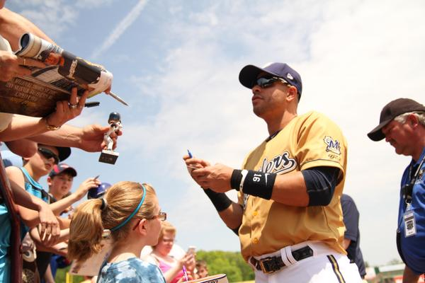Aramis Ramirez signs autographs for Wisconsin Timber Rattlers fans during his 2014 rehab stint with the team. (Photo courtesy of the Timber Rattlers)