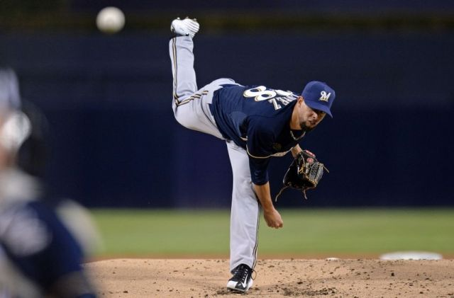 Milwaukee Brewers RHP Jorge Lopez pitches during the 1st inning of his MLB debut Tuesday. (Photo by Jake Roth/USA TODAY Sports)