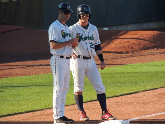 Cedar Rapids Kernels manager Jake Mauer (left) with outfielder Austin Diemer at third base during Game 3 of the 2015 Midwest League Championship Series. (Photo by Craig Wieczorkiewicz/The Midwest League Traveler)
