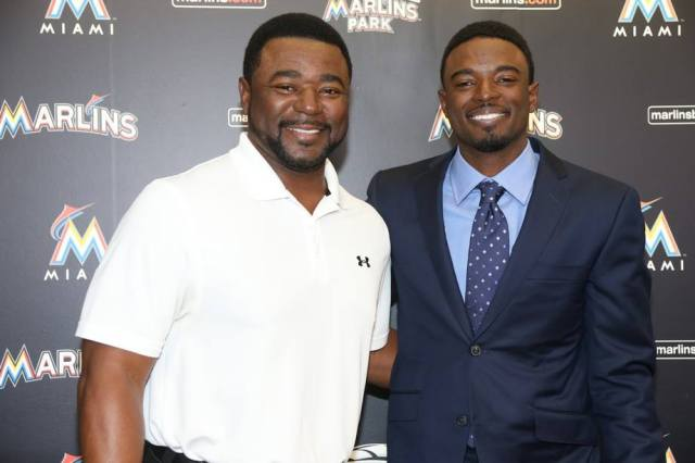 "Former MLB reliever Tom ""Flash"" Gordon (left) and son Dee Gordon pose during Dee's press conference Monday. (Photo courtesy of the Miami Marlins)"