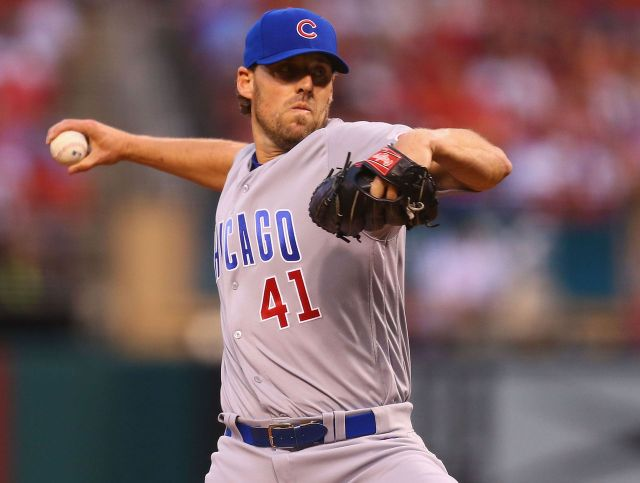 Chicago Cubs RHP John Lackey reached a pair of MLB milestones Monday. (Photo by Dilip Vishwanat/Getty Images)
