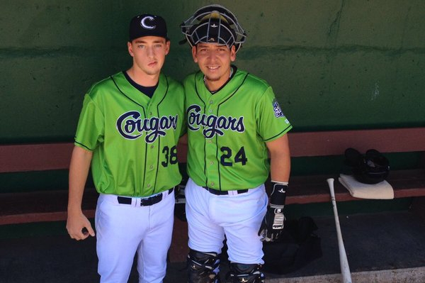 The Kane County Cougars debuted their new lime-green alternate jerseys Saturday. Seen here are RHP Taylor Clarke (left) and C Jose Queliz. (Photo tweeted by the Cougars)