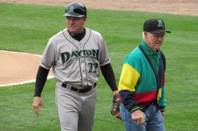 Dayton Dragons manager Dick Schofield heads off the field with his father Ducky after the latter threw out a ceremonial first pitch.