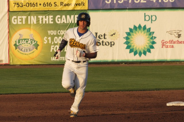 Burlington Bees 1B Michael Pierson rounds second base after homering to lead off the bottom of the 3rd inning.