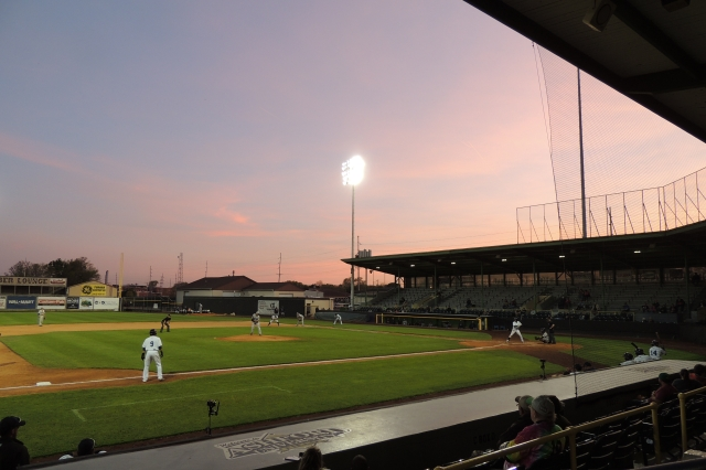 Purple and pink hues filled the sky at sunset during Thursday's game at Ashford University Field in Clinton, Iowa.