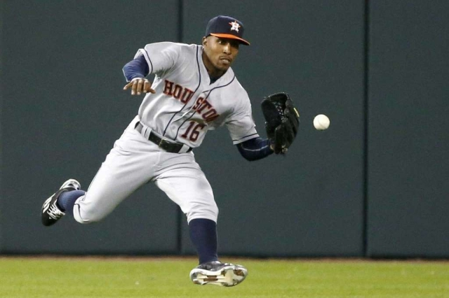 Tony Kemp fields a ball during his first major-league start for the Houston Astros on Wednesday. (Photo by Charles Rex Arbogast/The Associated Press)