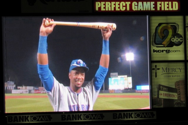 South Bend Cubs outfielder Eloy Jimenez is seen on the scoreboard hoisting his Top Star Award bat-trophy.