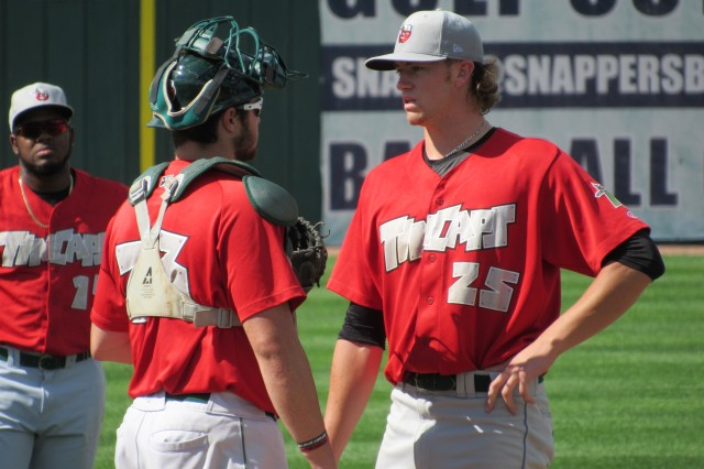 Pitcher Chris Paddack (right) talks with catcher Austin Allen while they wait for the TinCaps trainer.