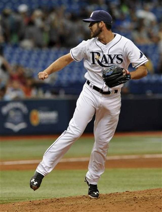 Tampa Bay Rays reliever Dylan Floro pitches during his major-league debut Thursday. (Photo by Steve Nesius/The Associated Press)
