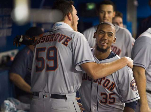 Teoscar Hernandez (right) gets a hug from pitcher Joe Musgrove after homering in his MLB debut Friday. (Screenshot from MLB.com video)