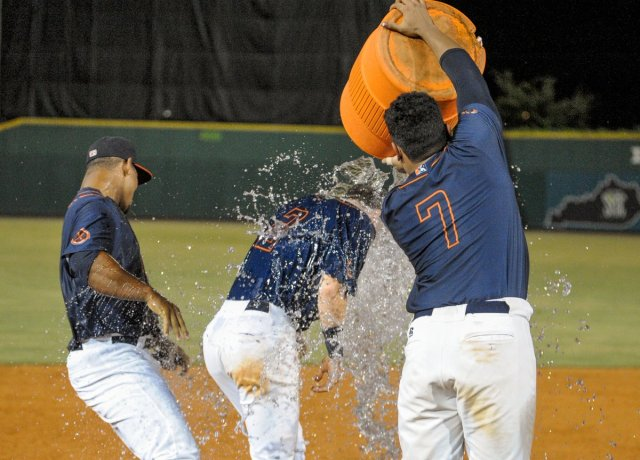 Jacob Cronenworth gets soaked by teammates after driving home the winning run in Bowling Green's 11-inning win Sunday. (Photo by Steve Roberts)