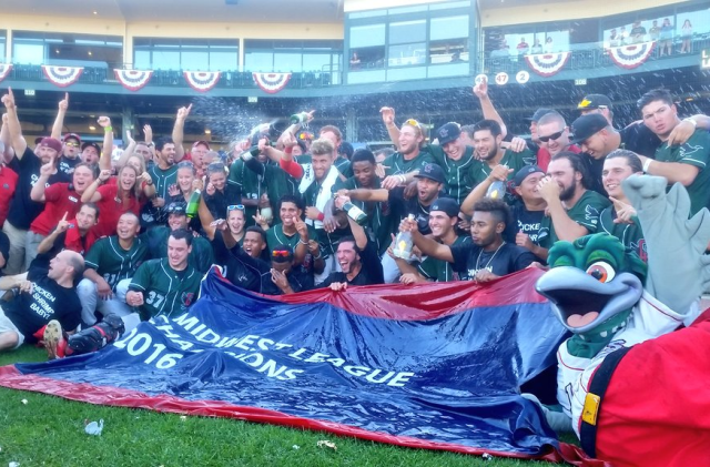 The Great Lakes Loons pose with the 2016 Midwest League Champions flag after winning the MWL title Sunday. (Great Lakes Loons photo)