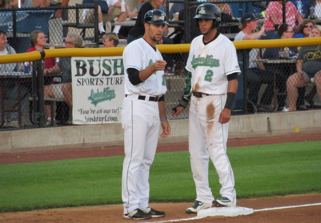 Clinton LumberKings manager Mitch Canham talks to outfielder Luis Liberato at third base.