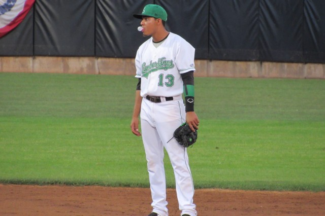 Clinton LumberKings shortstop Rayder Ascanio blows a bubble as he waits for the start of an inning.