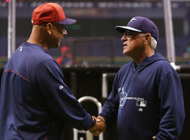 Terry Francona (left) and Joe Maddon shake hands during batting practice before an Indians-Rays game in 2013. (Photo by Chris Zuppa/Tampa Bay Times)