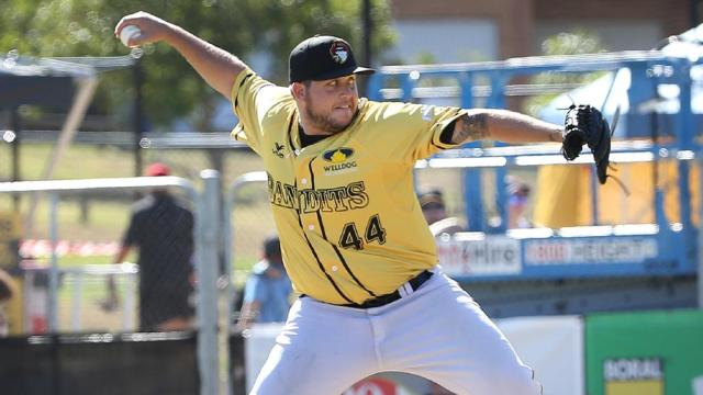Former Peoria Chiefs pitcher Ryan Searle picked up a two-inning save in the title-clinching game for the Brisbane Bandits. (Photo from perthnow.com)